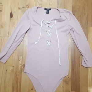 Plunging lace up long sleeve blush bodysuit